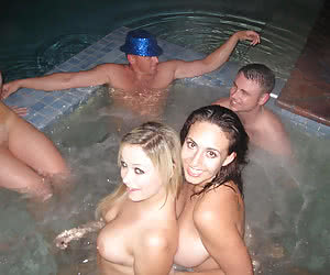 Lesbian and group foreplaying in a night pool