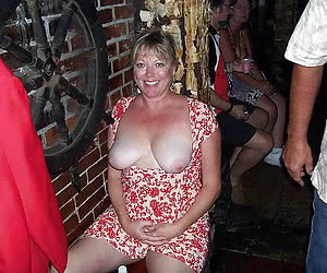 Mature wives having sexy fun on a night club party