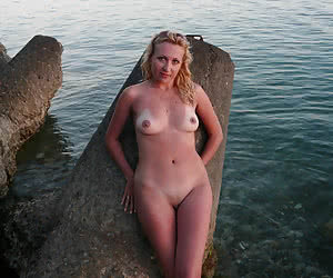 Naturist amateurs on a seashore in a evening sunset