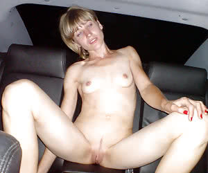 Pretty young girl flashing nude in front of a car