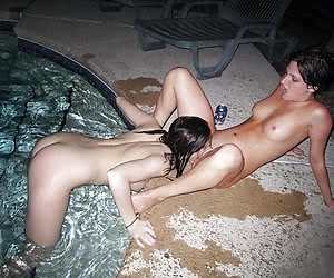 Young nudist amateurs having fun in a night pool