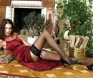 Brunette shows her perfect sexy legs in black stockings