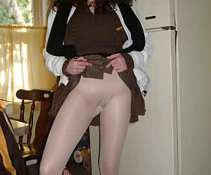 My four-eyed young wife poses in her pantyhose
