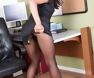 Secretary shows haired pussy through her tights
